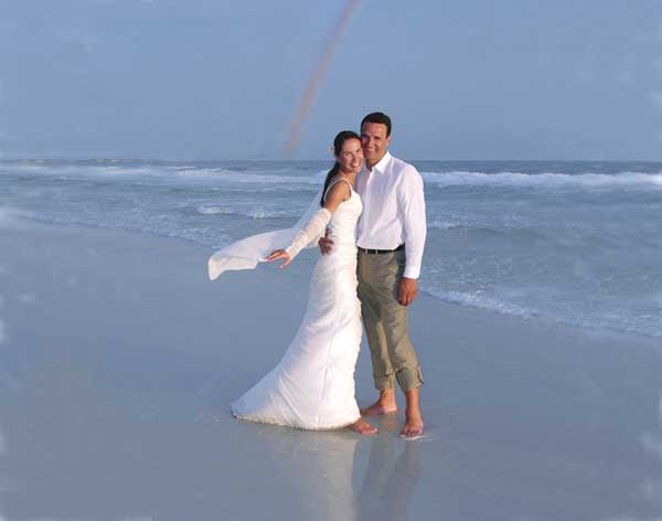 Beach wedding in Florida with ocean and rainbow by Jack Elka